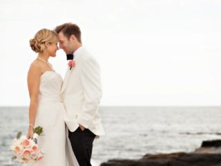 bride and groom near the water in Newport RI