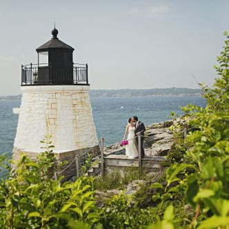 bride and groom in front of lighthouse at Castle Hill Inn Rhode Island